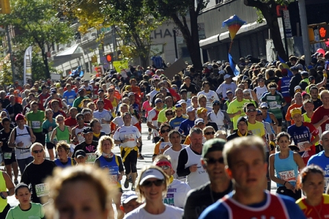 Runners make their way up 1st Avenue in
