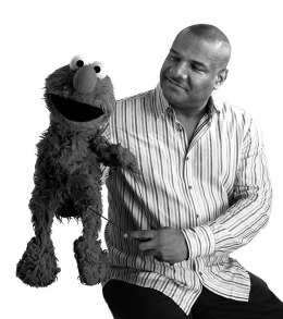 image: Kevin Clash sits with Elmo during a photo shoot with TIME in Oct. 2011.
