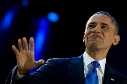 Image: President Barack Obama grins from the stage at his election night party at McCormick Place, Wednesday, Nov. 7, 2012, in Chicago, while proclaiming victory in the presidential election.