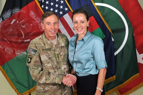 Handout photo of Commander of the International Security Assistance Force (ISAF)/U.S. Forces in Afghanistan General Petraeus shaking hands with author Broadwell