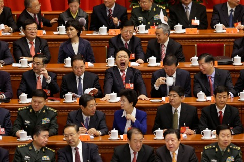 Delegates sit at stage before opening ceremony of 18th National Congress of Communist Party of China at Great Hall of People in Beijing