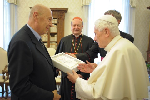 Pope Benedict XVI holds a copy of his book