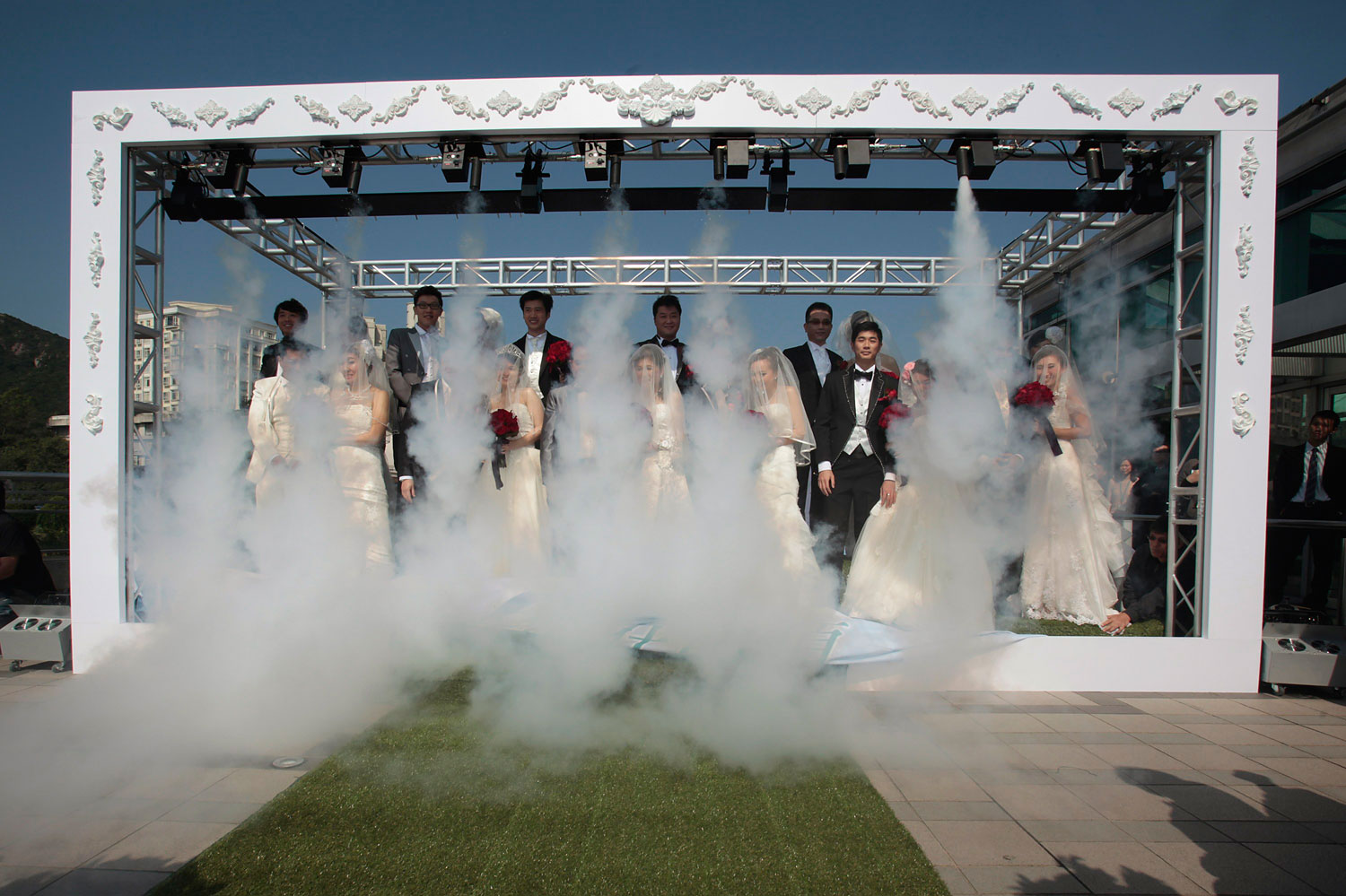 image: Twelve couples attend a wedding ceremony in Hong Kong.