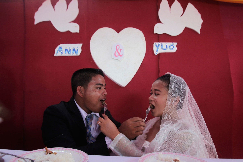 image: Ronnel Piligrino and Anna Marie Poblacion celebrates their wedding in Osmena town, Philippines.