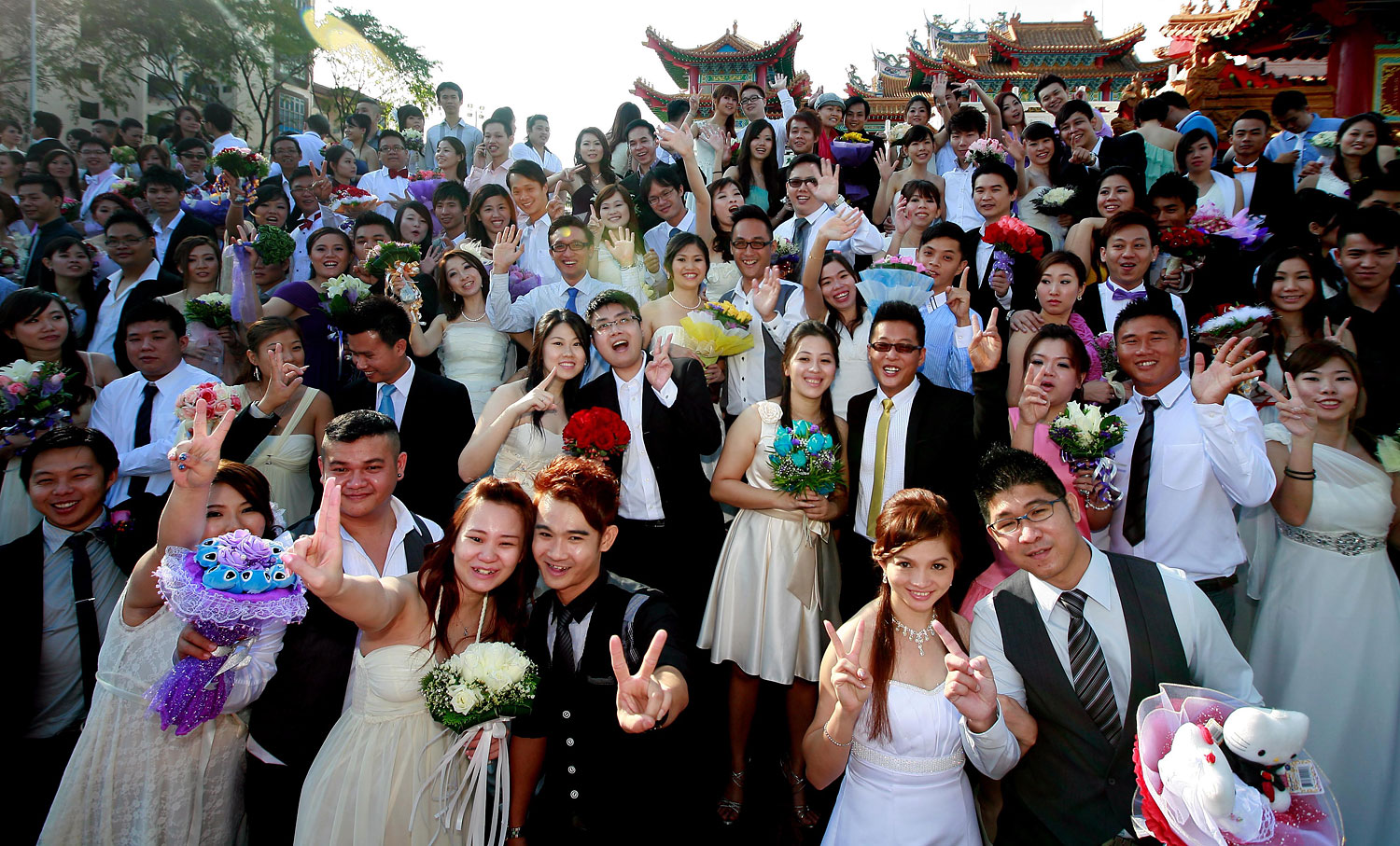 image: Newly wedded couples pose at a photo in Kuala Lumpur.