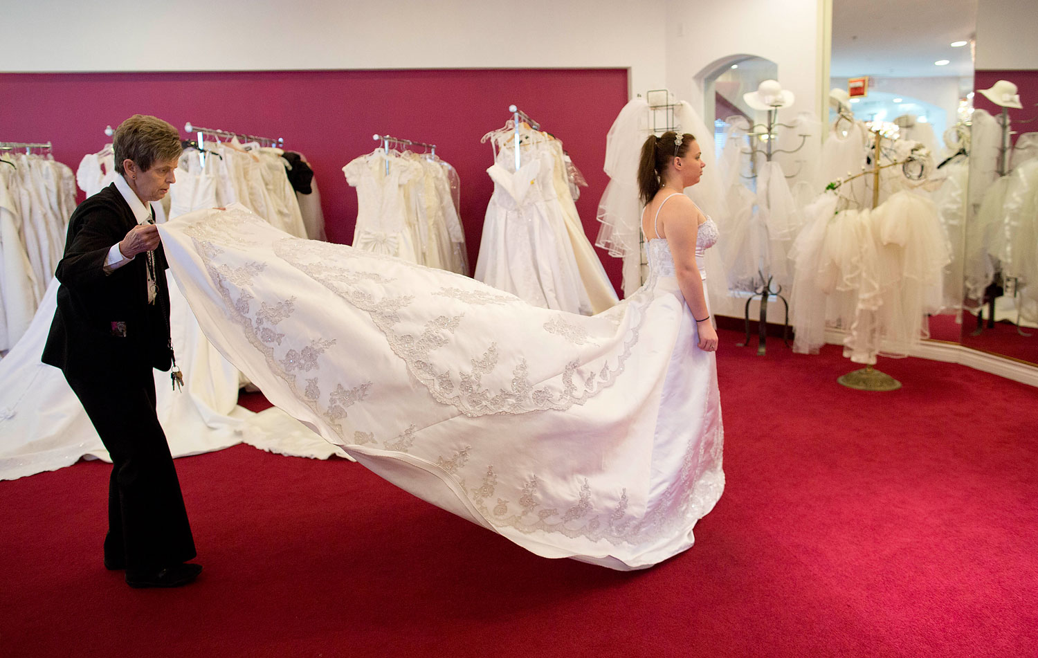 image: Bethany Wood, of Jackson, Mich., tries on a wedding gown before being married in Las Vegas.