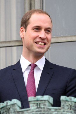 image: Prince William, Duke of Cambridge smiles from the balcony of Cambridge Guildhall, Nov. 28, 2012.