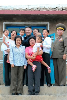 Image: North Korean leader Kim Jong-Un poses with residents as he visits a military unit on an island in the most southwest of Pyongyang.