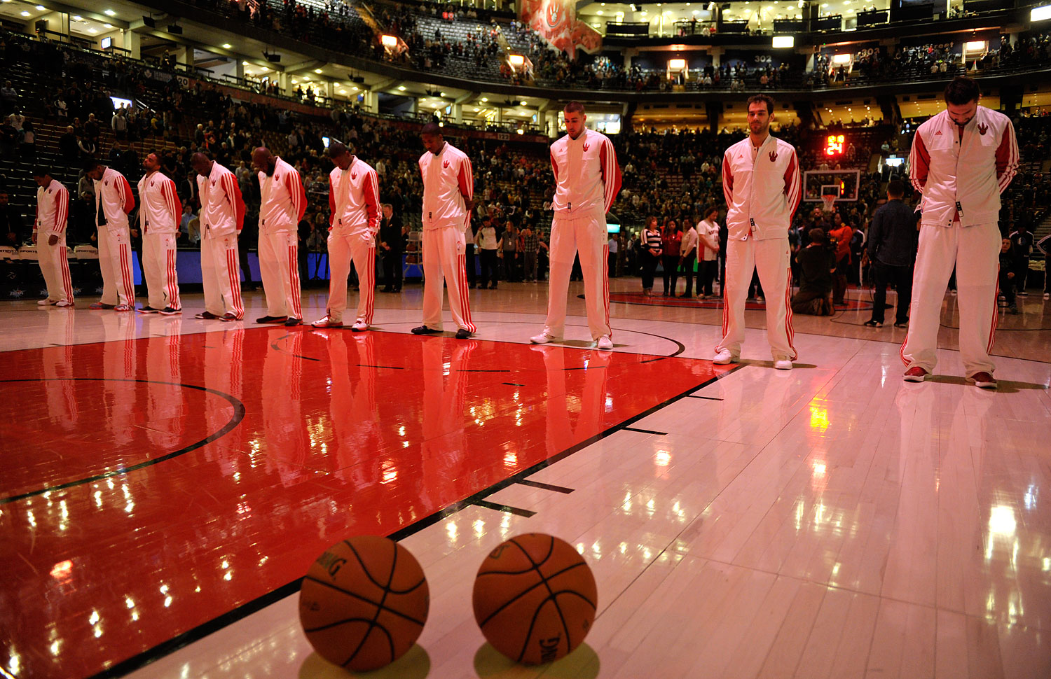 image: Members of the Toronto Raptors observe a moment of silence in remembrance of the shooting victims at Sandy Hook Elementary School in Newtown Connecticut before their NBA basketball game in Toronto