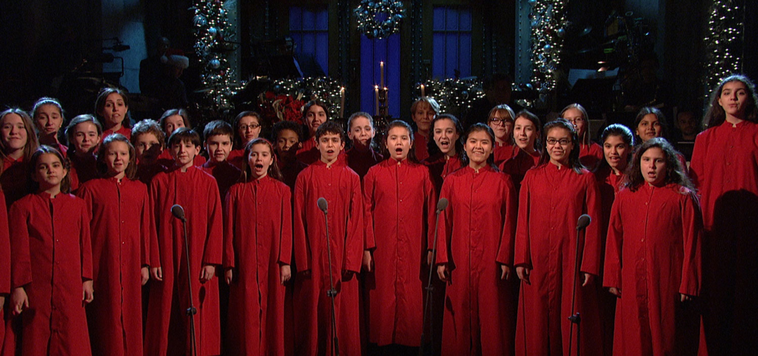 """image: Members of the New York City Children's Chorus perform """"Silent Night"""" during the opening of Saturday Night Live as a tribute to the victims of those killed during the Sandy Hook shooting."""