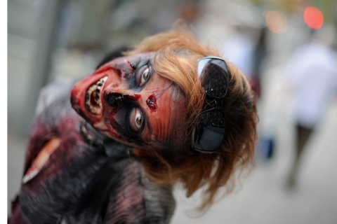 An actress portraying a zombie poses