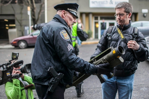Seattle Police Department Sgt. Paul Gracy seizes a missile launcher from Mason Vranish after he purchased from an outside of a gun buyback program in Seattle