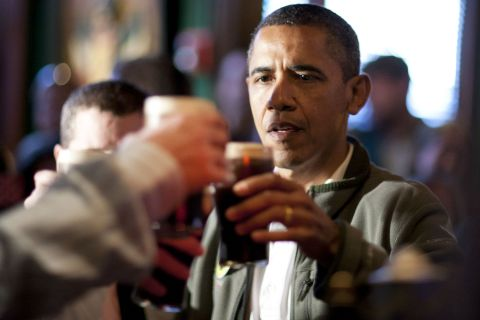 image: President Barack Obama toasts with Guinness beer on March 17, 2012 in Washington, DC in honor of St. Patrick's Day.
