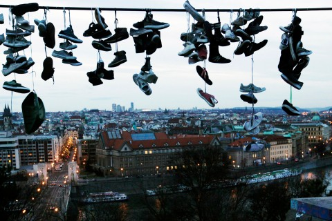 Shoes hang on power line at Letna park overlooking Prague