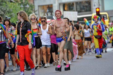 Participants march at an annual gay pride parade in central Stockholm