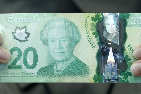 image: The new Canadian $20 dollar bill made of polymer is displayed at the Bank of Canada in Ottawa May 2, 2012.