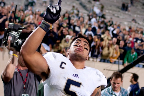 image: Notre Dame linebacker Manti Te'o points to the sky as he leaves the field after a 20-3 win against Michigan State in East Lansing, Mich., Sept. 15, 2012.