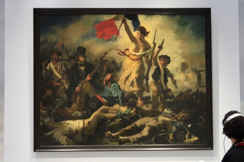 """A woman looks at Eugene Delacroix 's painting named """"Liberty Leading the People (28 July 1830)  at the Le Louvre Lens Museum, in Lens"""