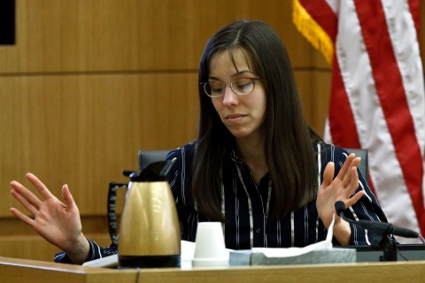 Jodi Arias gestures toward the jury as she speaks from the witness stand in Maricopa County Superior Court