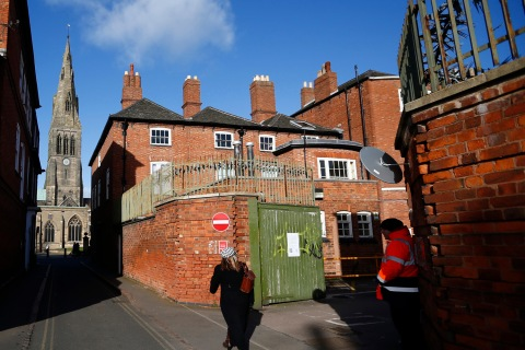 A guard stands at the entrance to the car park where the skeleton of King Richard III was discovered in Leicester