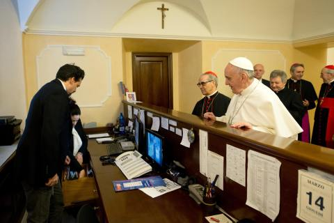 Newly elected Pope Francis I, Cardinal Jorge Mario Bergoglio of Argentina, checks out of the church-run residence where he had been staying in Rome on March 14, 2013.