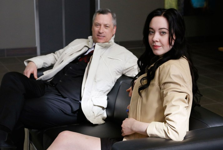 Paul Dickerson and Kami Mahoney pose in bulletproof jackets designed to look like everyday clothes at the offices of Elite Sterling Security in Aurora