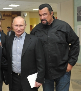 image: Russian President Vladimir Putin, left, and U.S. movie actor Steven Seagal visit a new sports arena in Moscow, Wednesday, March 13, 2013.