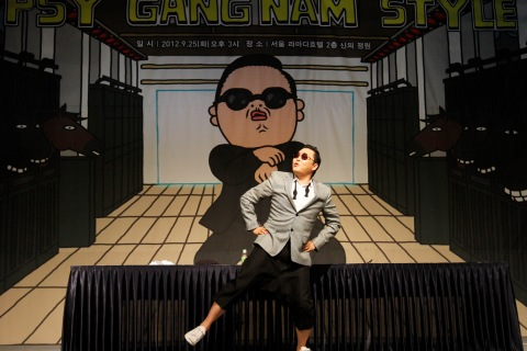 South Korean singer Psy dances after a news conference at a hotel in Seoul