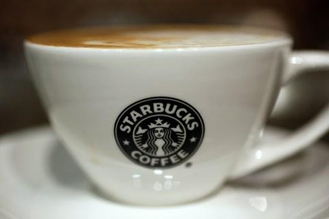A cup of coffee is seen in Starbucks' Vigo Street branch in Mayfair, central London