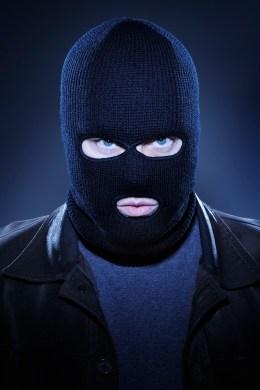 Image: Man Wearing Ski Mask and Staring