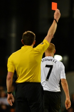 image: Referee Lee Probert (left) shows Fulham's English midfielder Steve Sidwell the red card during an English Premier League football match between Fulham and Queens Park Rangers, London, April 1, 2013.