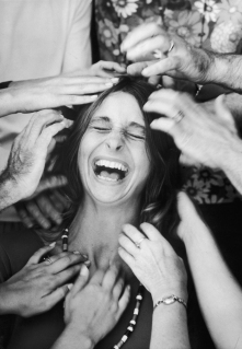 A woman roars with laughter as she undergoes a head-tapping session, part of a sensory awareness class at the Esalen Institute in Big Sur, Calif., on Oct. 1, 1970.