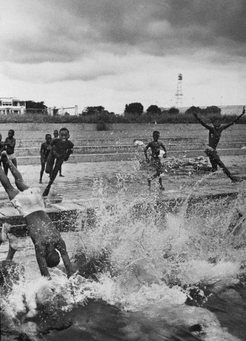 Children swimming in a pool run by priests in the Belgian Congo.