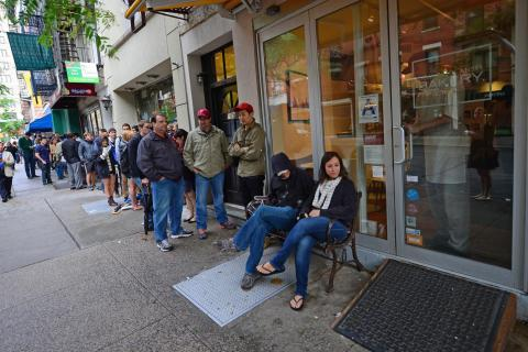image: Customers wait in line to buy cronuts, a croissant-doughnut hybrid, the brain child of French pastry chef Dominique Ansel, at Ansel's bakery shop in New York on June 14, 2013.