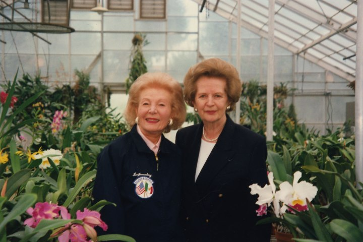 Lee Annenberg and Maragaret Thatcher view the orchids in the greenhouse during Thatcher's visit, Feb. 1995.