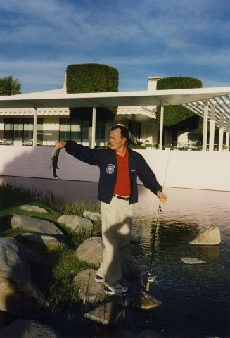 Former president George H.W. Bush fishing in one of the many well-stocked lakes at Sunnylands, Feb. 1995.