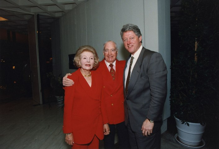 President Bill Clinton poses with Walter and Lee Annenberg at the entrance to the estate house during Clinton's visit on Valentine's Day 1995.