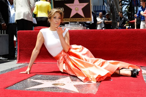 Singer and actress Lopez blows a kiss at photographers as she poses on her star after it was unveiled on the Walk of Fame in Hollywood, California