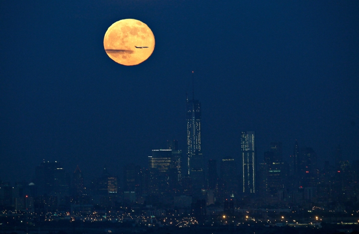 A full moon also referred to as a super moon rises over New York as seen from West Orange, New Jersey