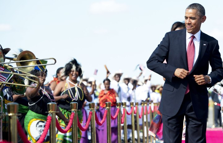 U.S. President Barack Obama dances to music upon arrival on Air Force One at Julius Nyerere International Airport in Dar Es Salaam, Tanzania, on July 1, 2013.