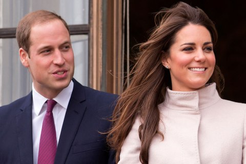 Prince William, Duke of Cambridge and Catherine, Duchess of Cambridge stand on the balcony of The Guildhall during their first official visit to Cambridge on Nov. 28, 2012 in Cambridge, England.