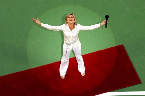 Australia's Olivia Newton-John looks up after performing at the Australian Open tennis championship in Melbourne, January 30, 2005.
