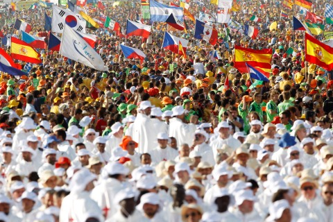 Pilgrims attend a mass led by Pope Benedict XVI at the Cuatro Vientos aerodrome as part of World Youth Day festivities in Madrid