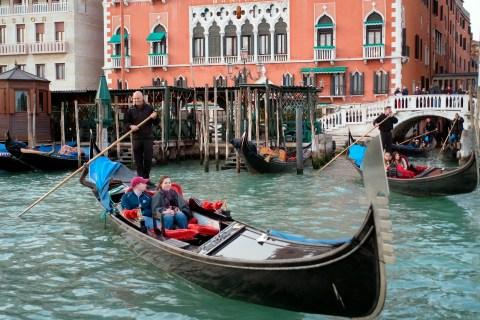 Gondola pass in front of Danieli hotel at Palazzo Dandolo in Venice