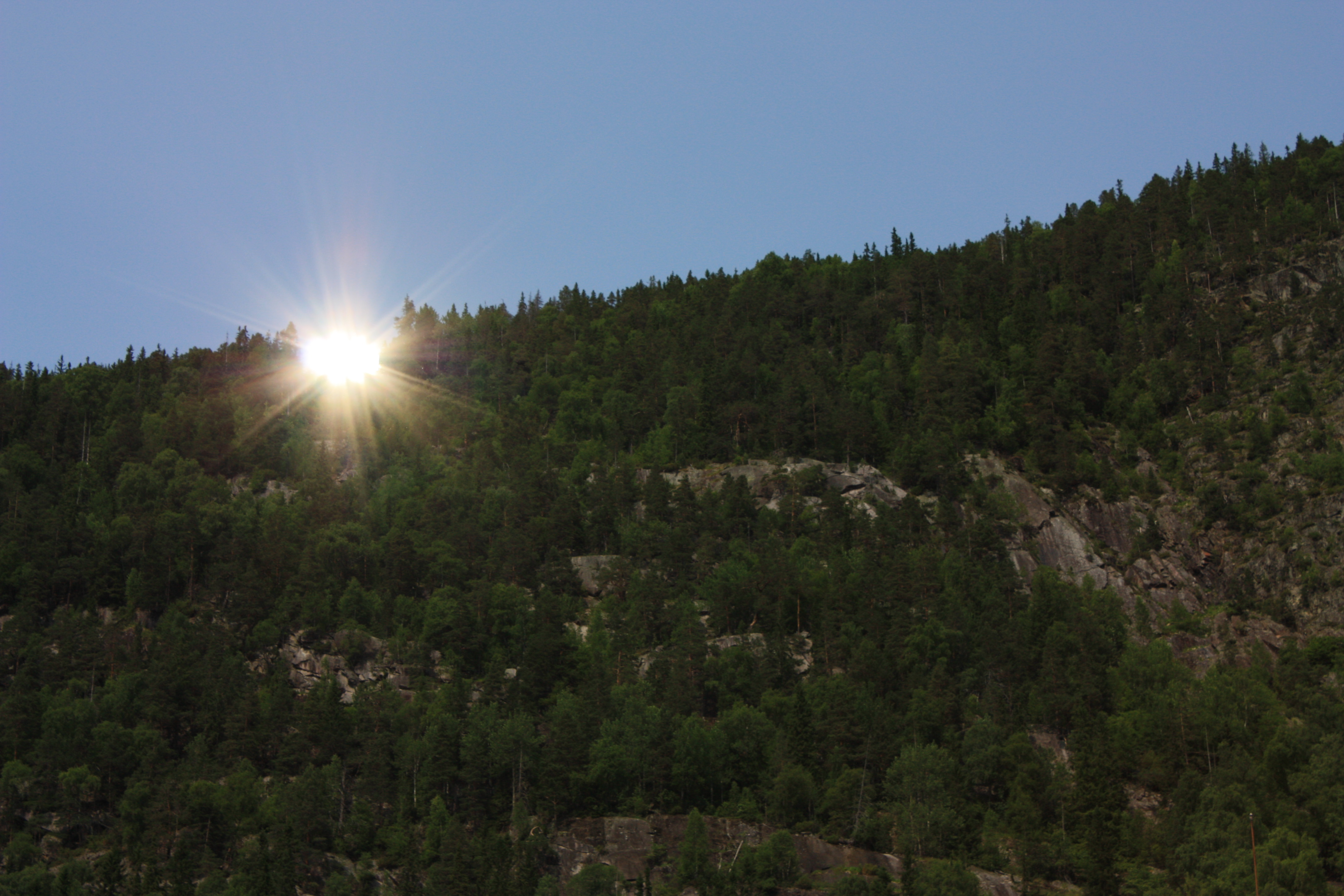Solspeilet reflekterer foto Tinn kommune