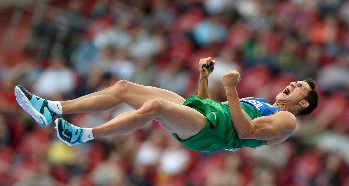 Augusto de Oliveira of Brazil celebrates after clearing the bar at the men's pole vault final during the IAAF World Athletics Championships at the Luzhniki stadium in Moscow, on Aug. 12, 2013.