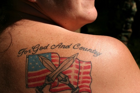 Pierce displays her tattoo during the Light Foot Militia annual gathering on Bureau of Land Management land near Priest River, Idaho