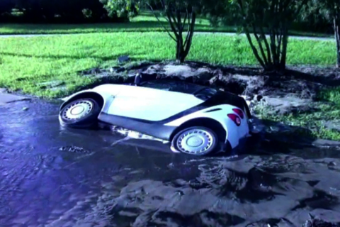 Sinkhole Swallows Smart Car
