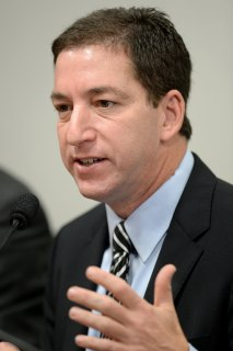 The Guardian's Brazil-based reporter Glenn Greenwald testifies before the investigative committee of the Senate that examines charges of espionage by the United States in Brasilia on October 9, 2013.