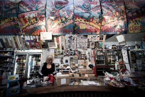 A woman works at the local grocery store in Christiania, in Copenhagen.